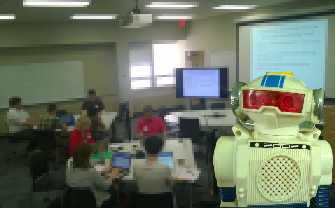 toy robot in front of blurred classroom