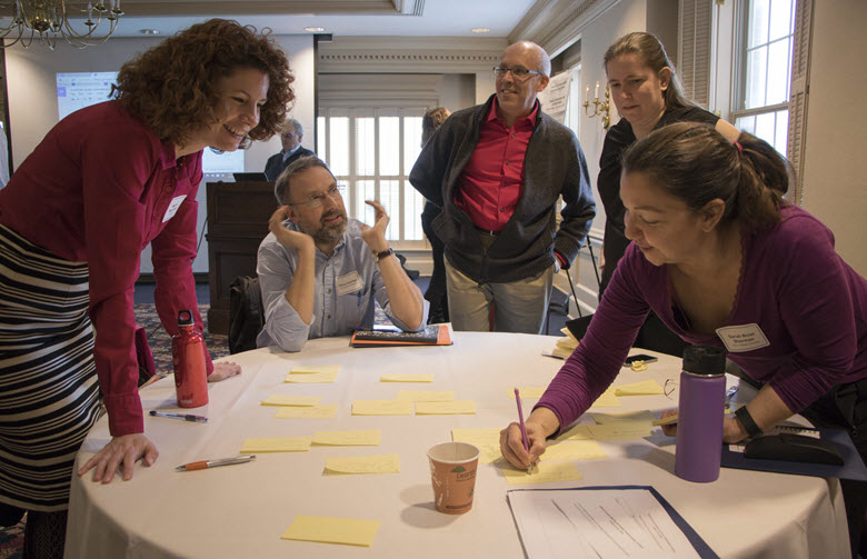 Participants in the Trestle launch meeting work in a brainstorming session