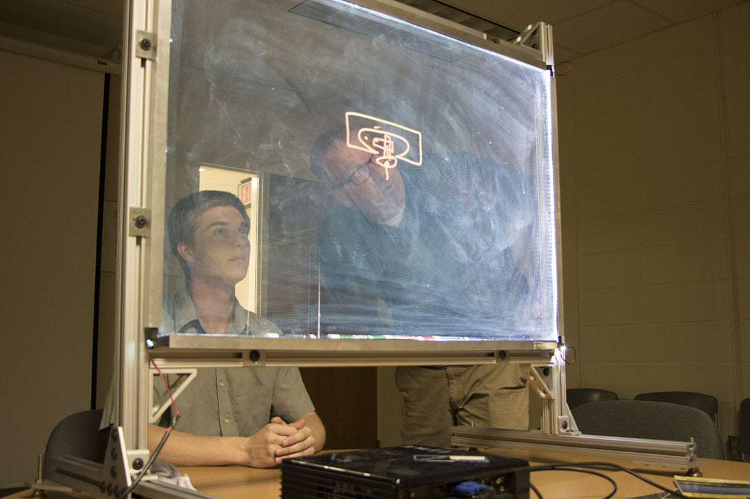 conner brown and john rinnert inspect the new lighboard