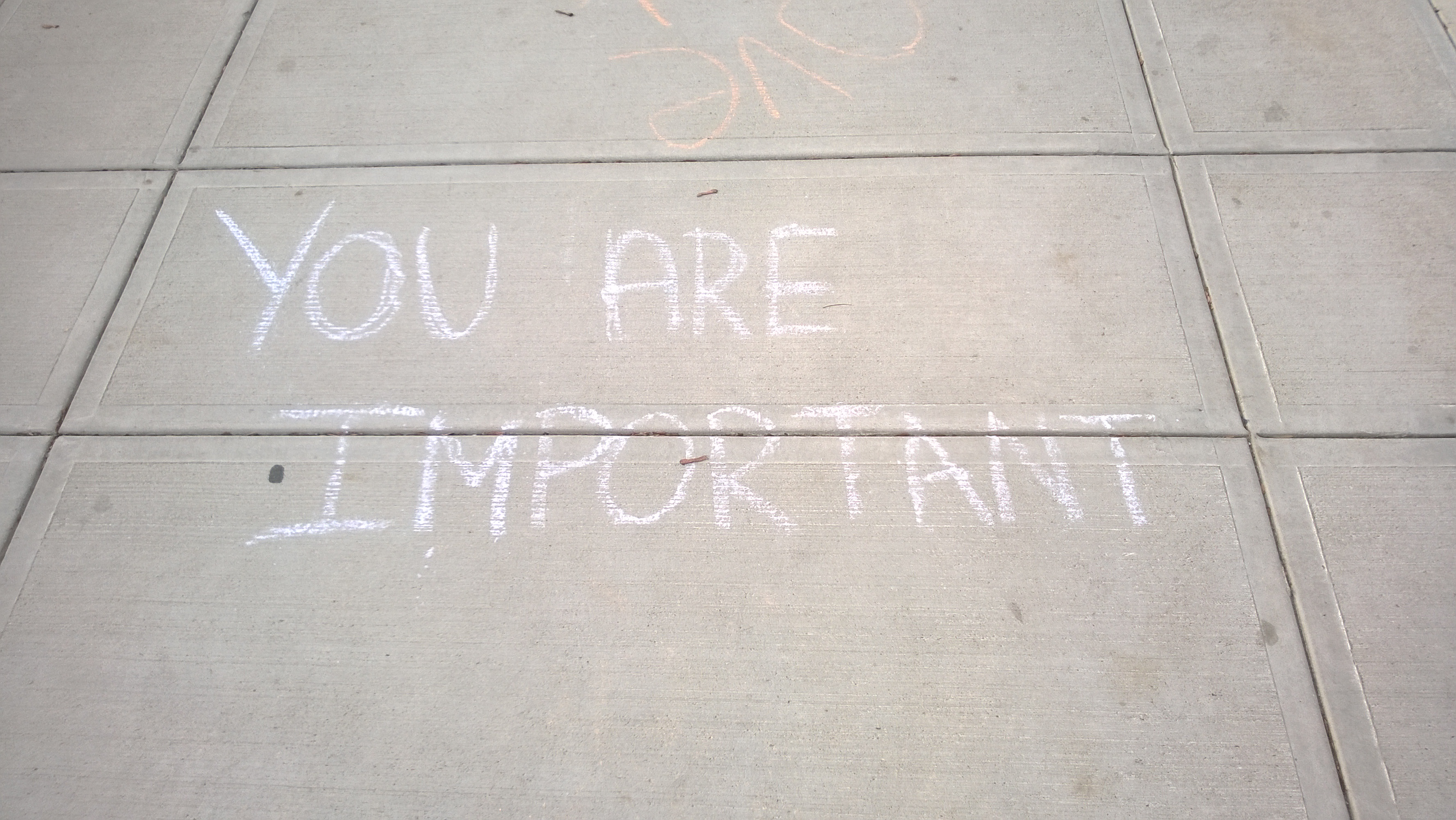 sidewalk chalk message that says you are important