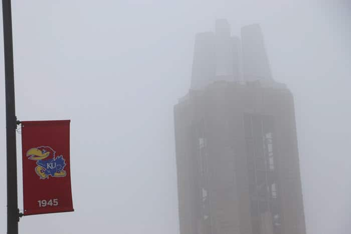 top of campanile and ku flag in fog