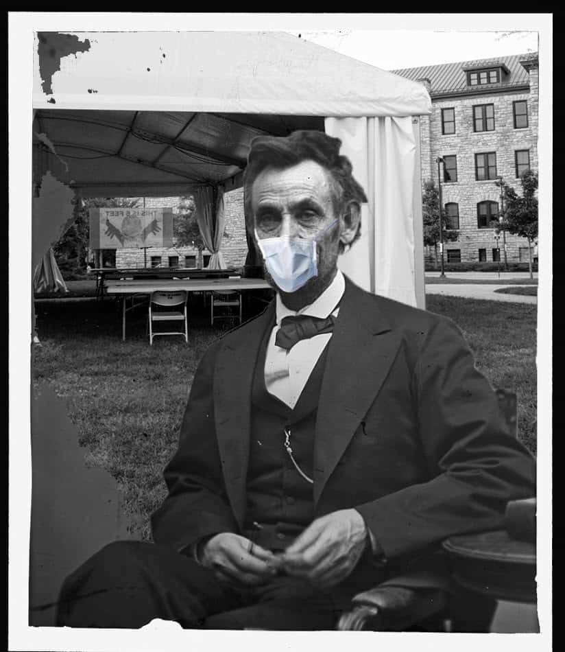 satirical image of Abraham Lincoln in a mask near a tent on the KU campus